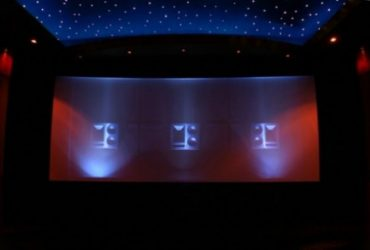 What is an acoustically transparent projector screen?